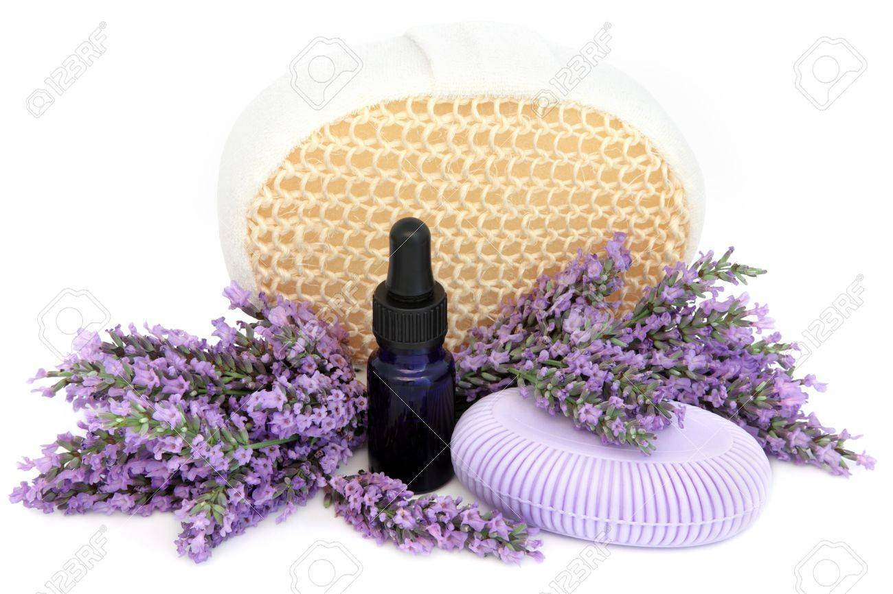 Lavender herb flower sprigs, soap, exfoliating scrub and aromatherapy essential oil bottle over white background Stock Photo - 19754112