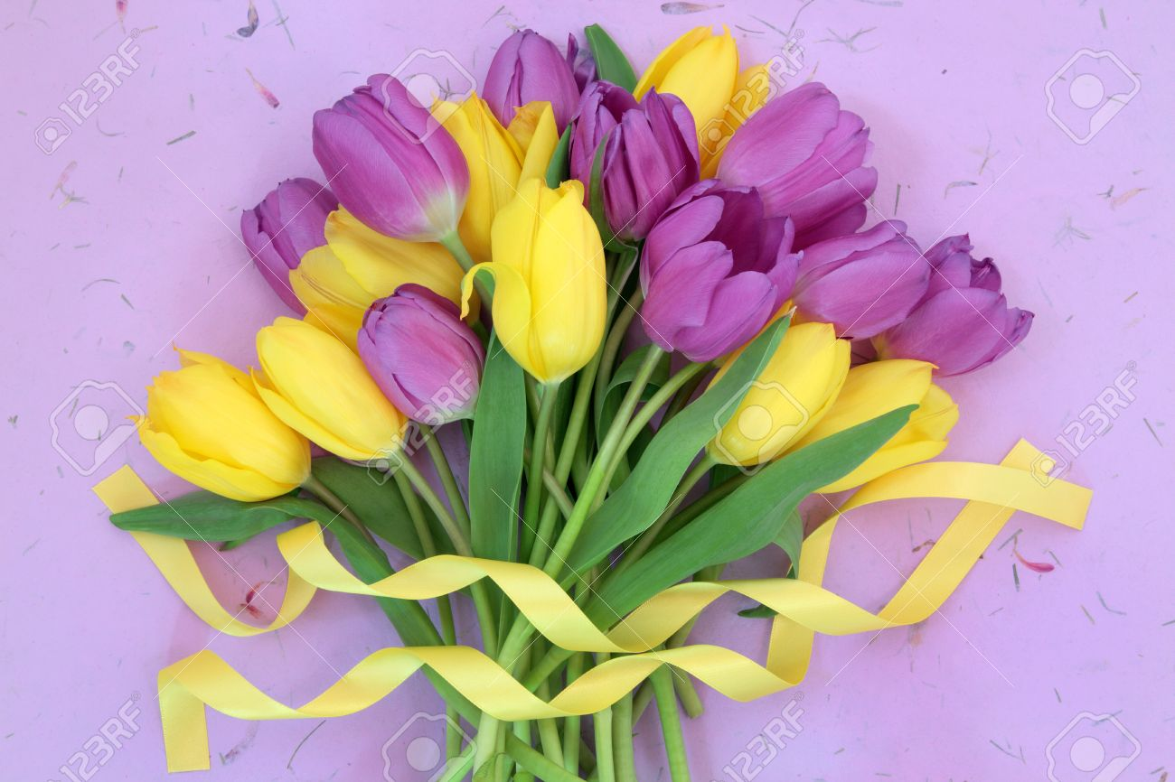 Yellow and purple tulip flower bouquet with ribbon over mottled stock photo yellow and purple tulip flower bouquet with ribbon over mottled lilac background mightylinksfo