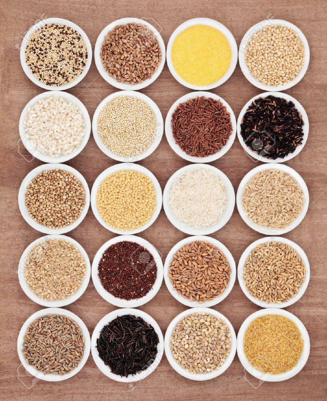 Large grain food selection in white porcelain bowls over papyrus background - 20429019