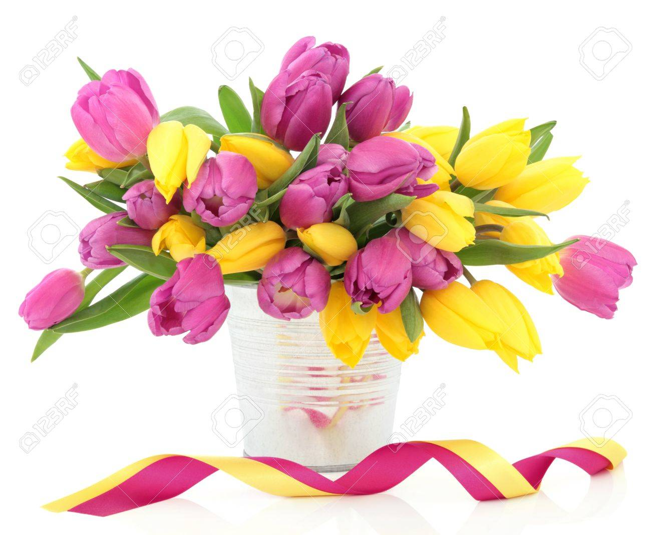 Pink And Yellow Tulip Flower Arrangement In A Metal Vase With