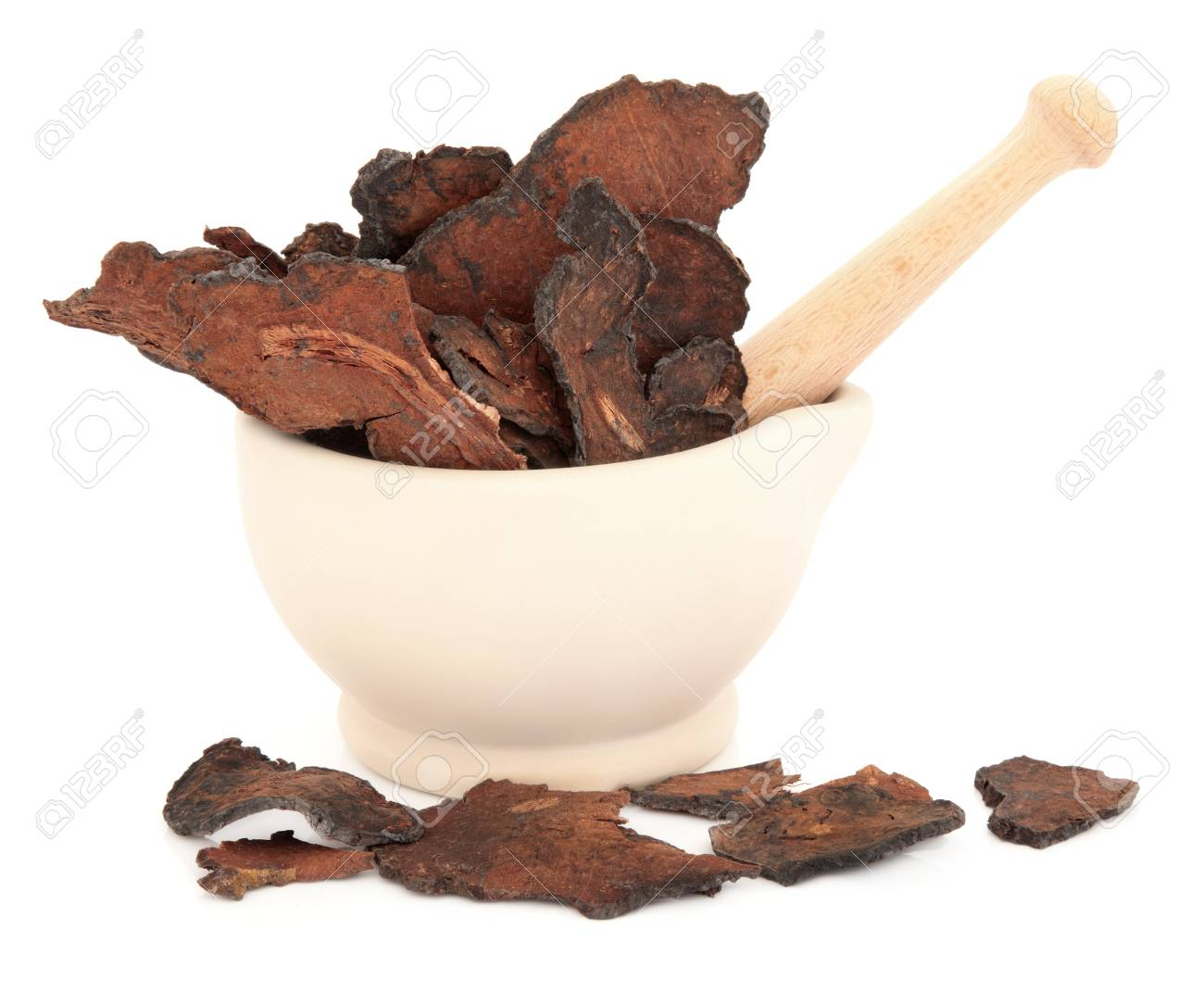 Chinese Herbal Medicine Fleece Flower Root In A Stone Mortar Stock