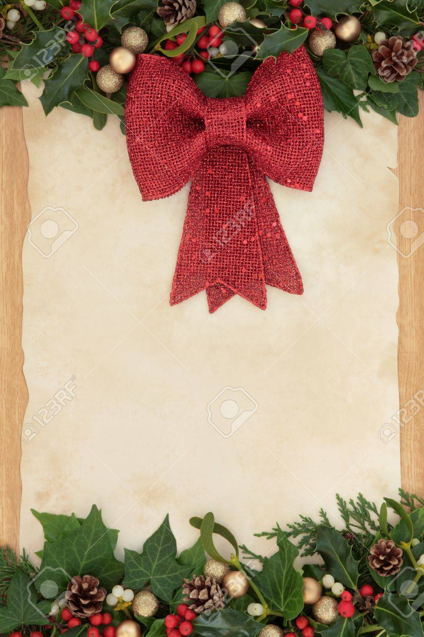 Christmas Border Decoration With Red Bow Holly Ivy And Mistletoe