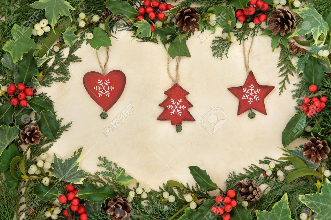 Christmas floral border stock photos freeimages com - Christmas Floral Border With Wooden Bauble Decorations Holly Ivy And Mistletoe On Old Parchment