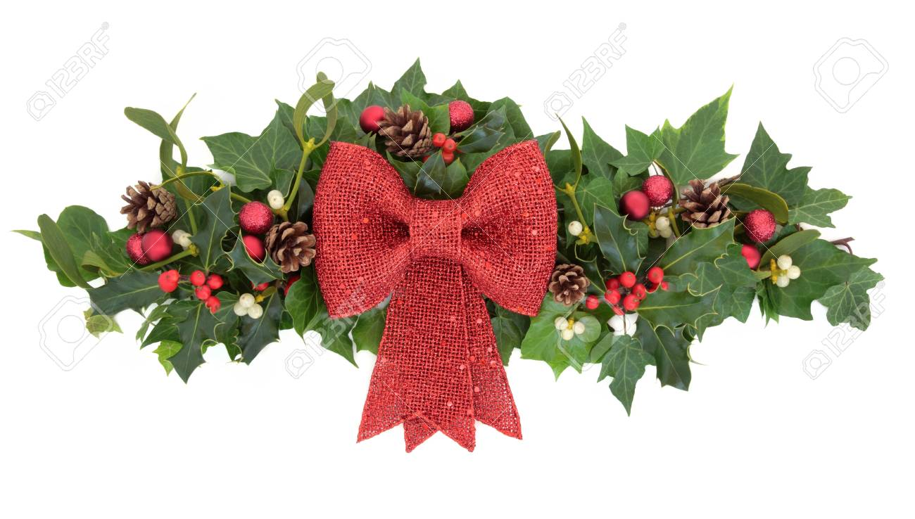 Christmas Floral Decoration With Red Bow Baubles Holly Mistletoe