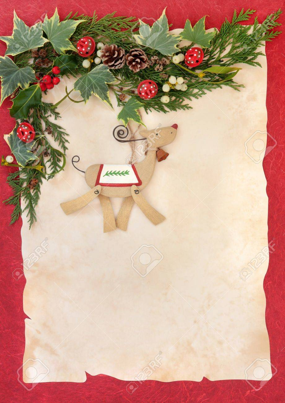 Christmas floral border stock photos freeimages com - Christmas Floral Border With Retro Wooden Dog Bauble Red Bells Holly Mistletoe And
