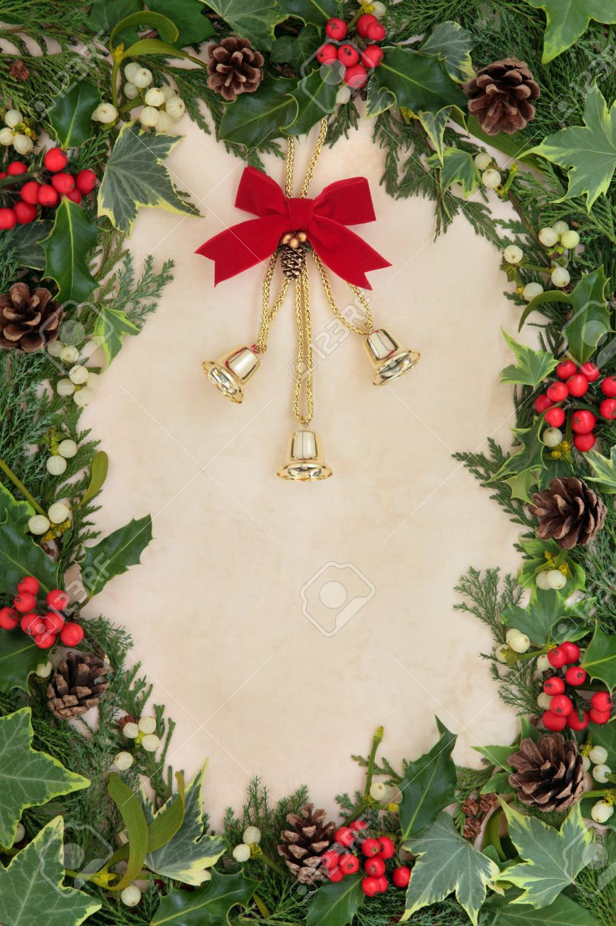 Christmas floral border stock photos freeimages com - Christmas Floral Border With Bell Decoration Holly Ivy And Mistletoe On Old Parchment Paper