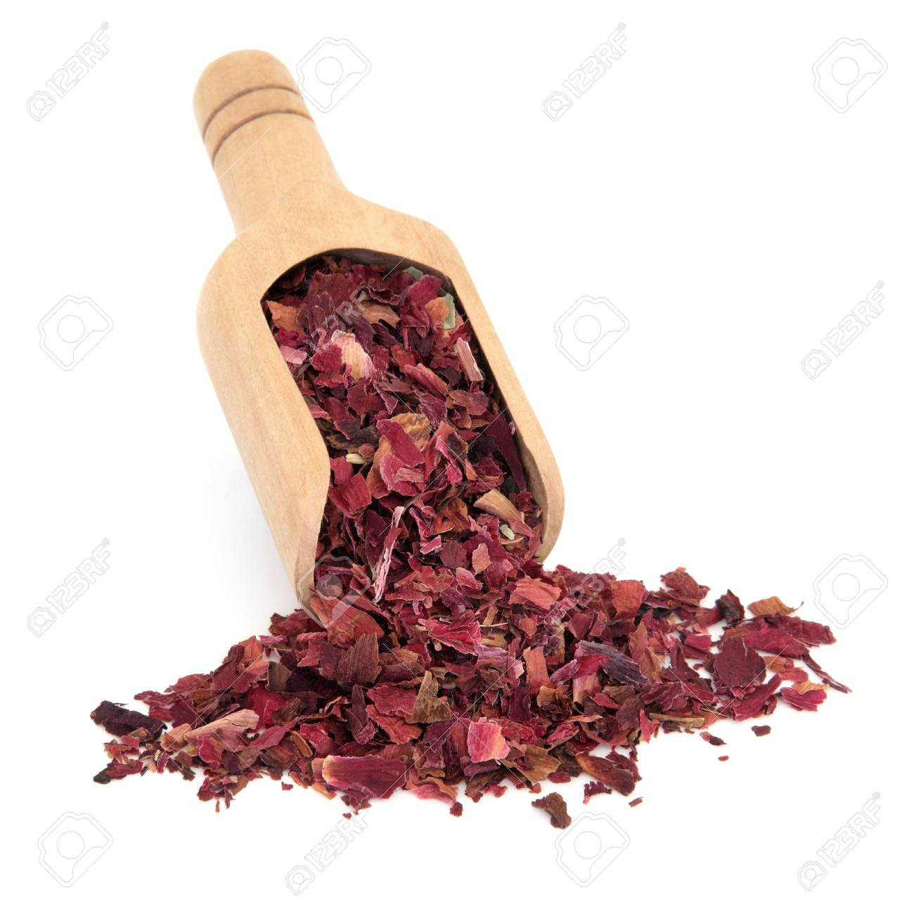 Peony Flowers Used In Chinese Herbal Medicine In A Wooden Scoop