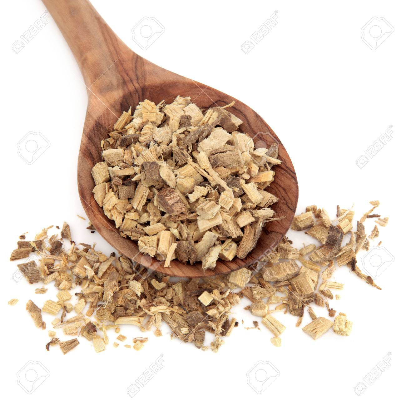 Chinese herbal products - Licorice Root Used In Chinese Herbal Medicine And Food Products In A Wooden Spoon Over White