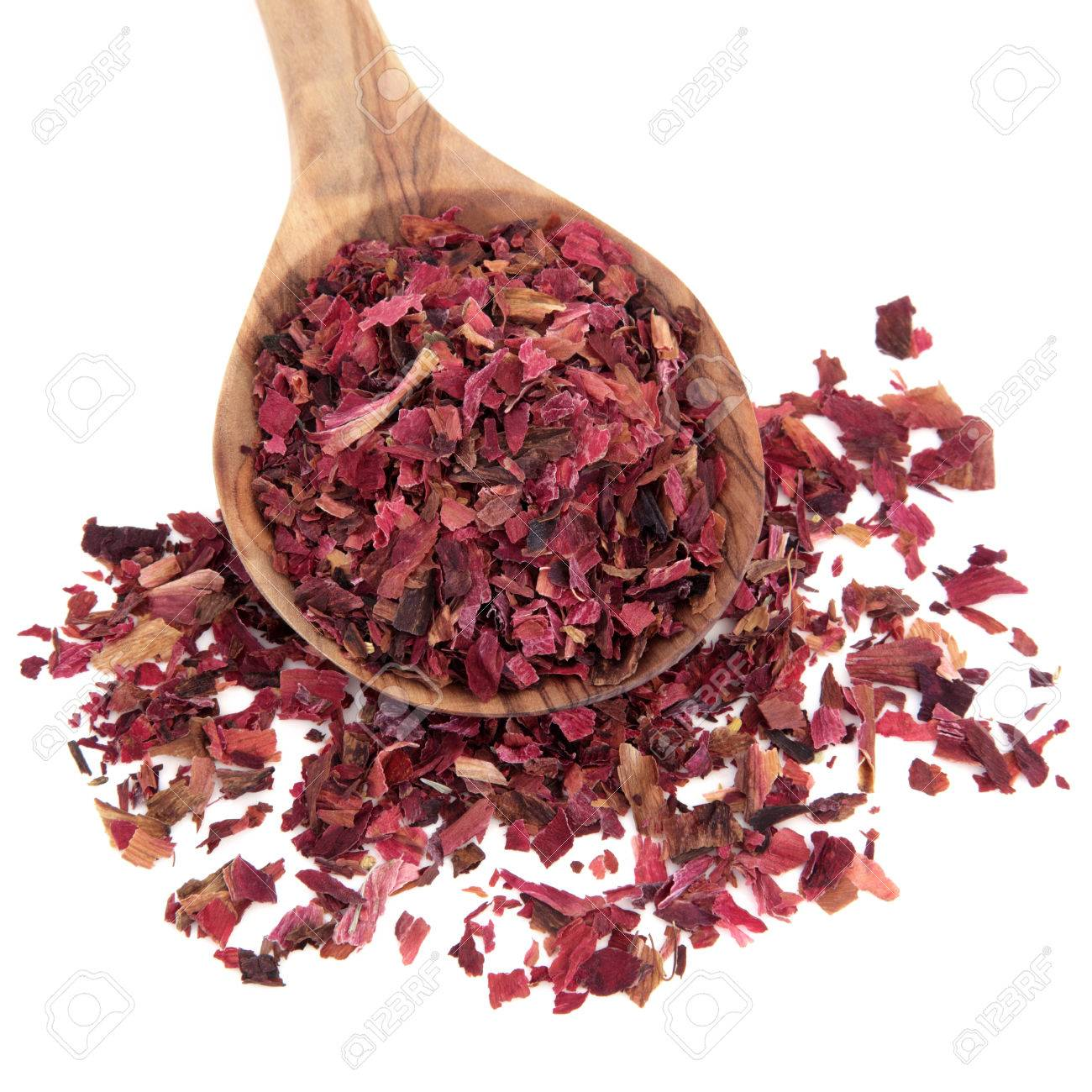 Peony Flowers Used In Chinese Herbal Medicine In A Wooden Spoon