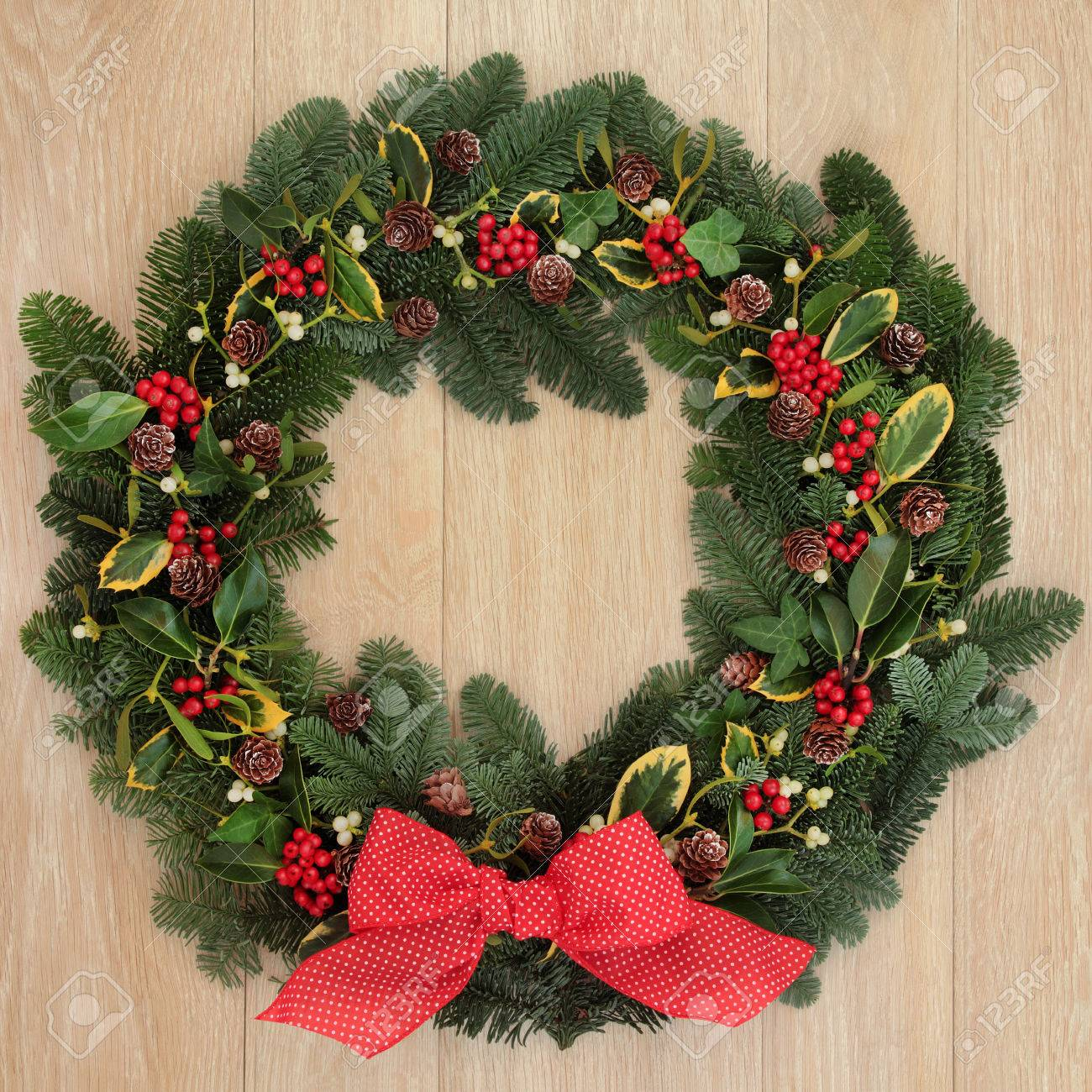 Christmas And Winter Wreath With Red Bow Holly Ivy Mistletoe