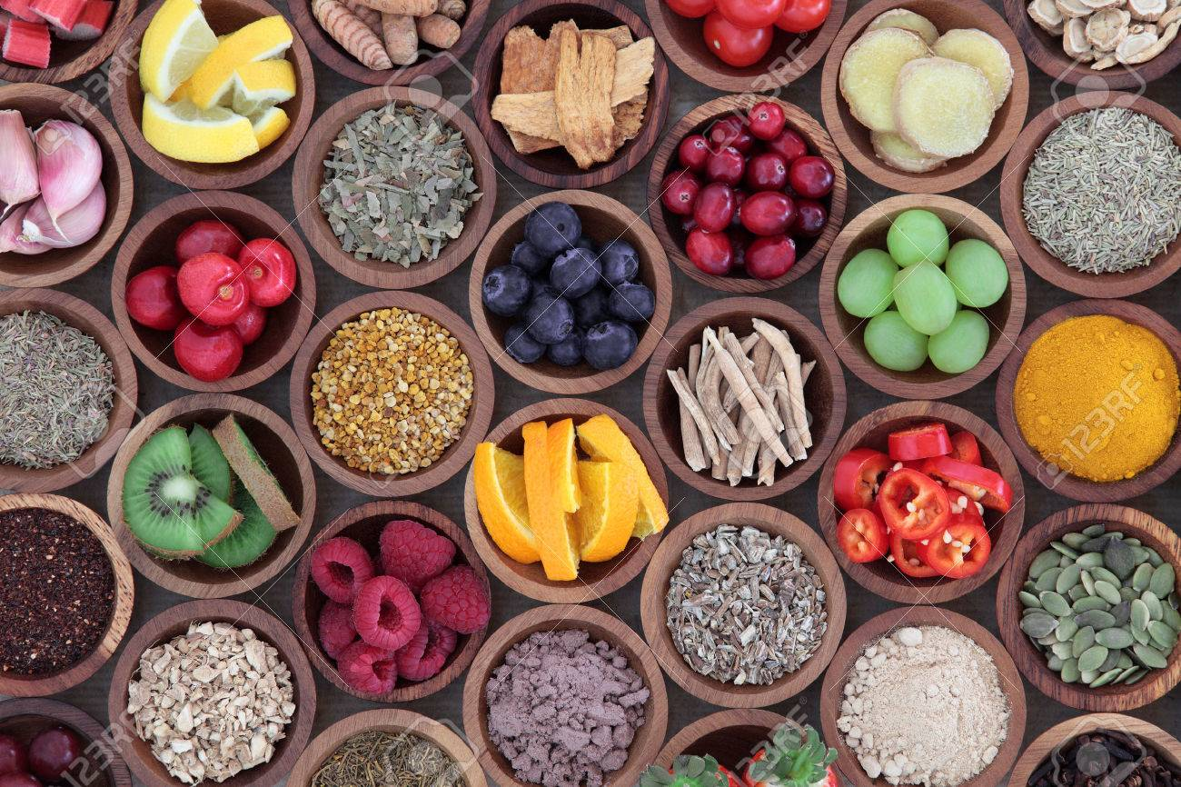 Health and super food  to boost immune system in wooden bowls, high in antioxidants, anthocyanins, minerals and vitamins. Also good for cold and flu remedy. Stock Photo - 58544882