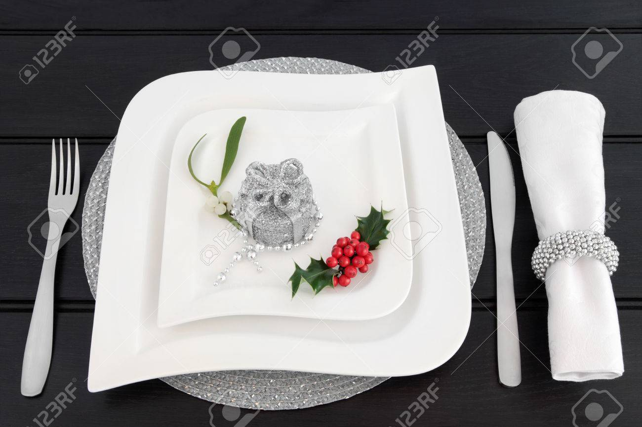 Christmas Dinner Table Setting With White China Plates, Cutlery ...
