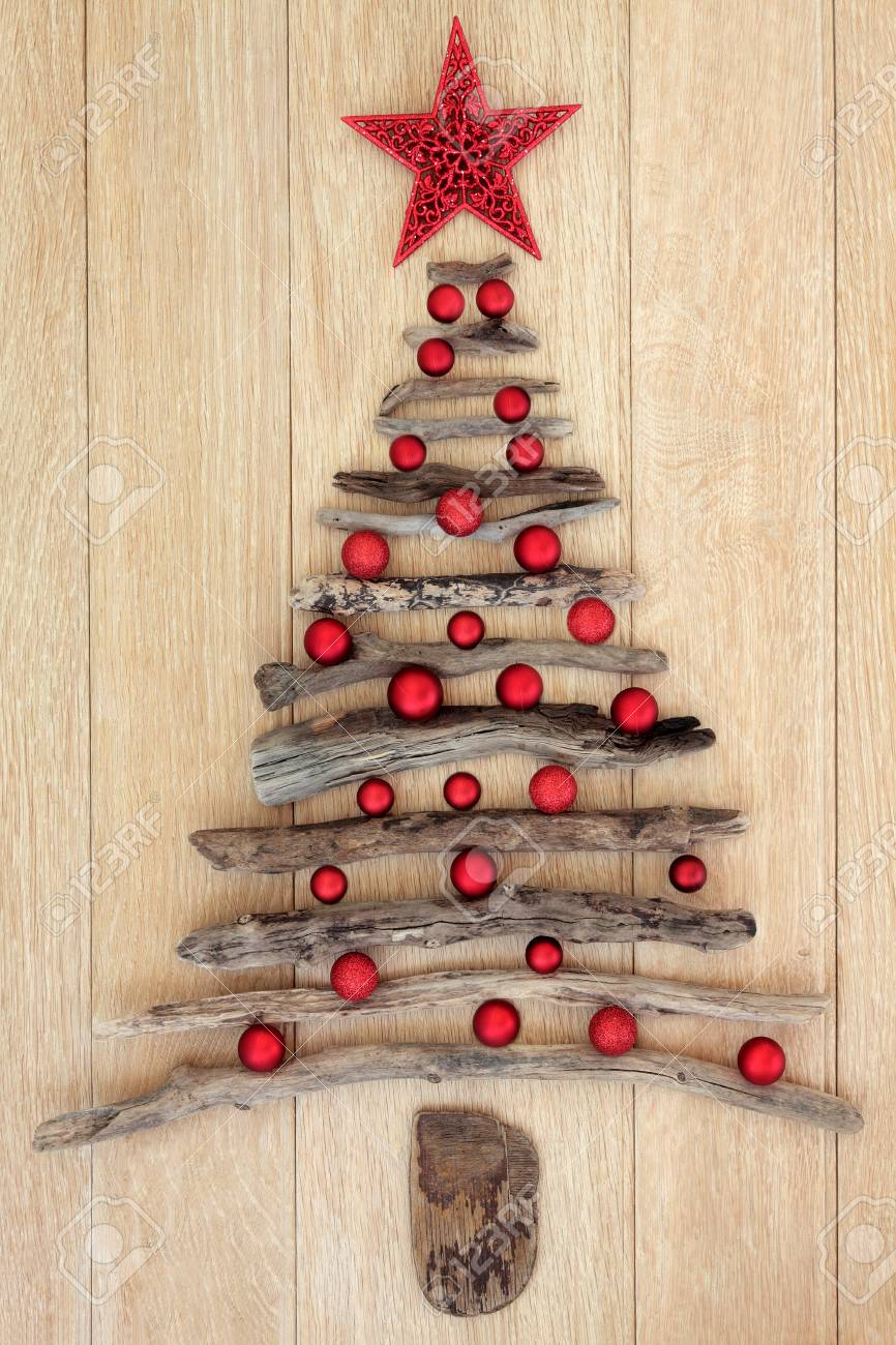 123RF.com & Abstract driftwood christmas tree with red star and bauble decorations..