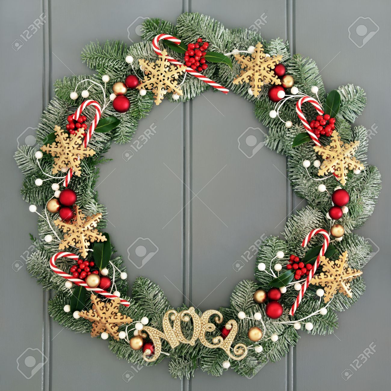 Christmas Wreath With Noel Sign And Snowflake Decorations Candy Stock Photo Picture And Royalty Free Image Image 64715540