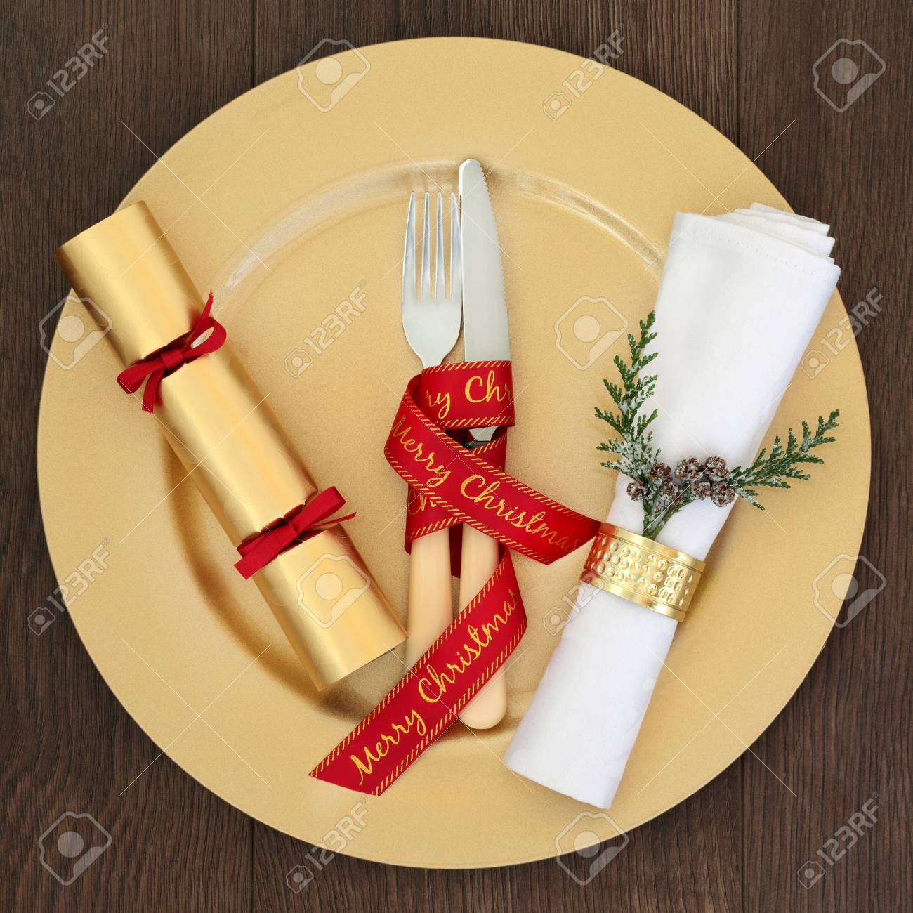 Christmas Dinner Table Place Setting With Gold Plate, Cutlery With Red  Ribbon, Napkin With