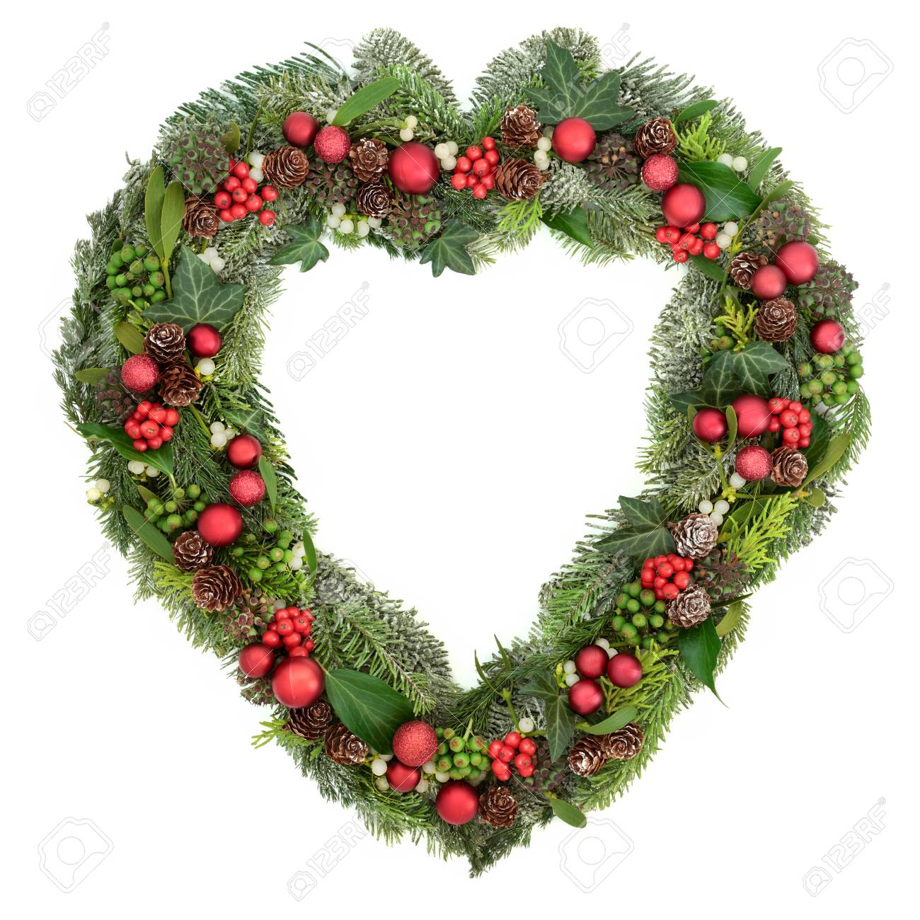 Christmas Heart Wreath.Decorative Heart Shaped Christmas Wreath With Red Bauble Decorations