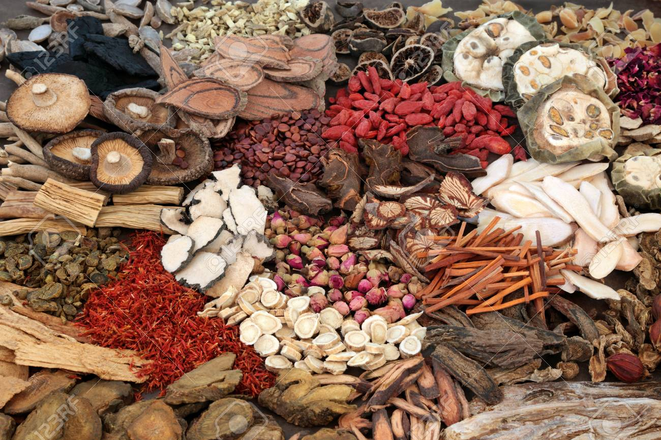 Traditional chinese herbs used in herbal medicine forming a background