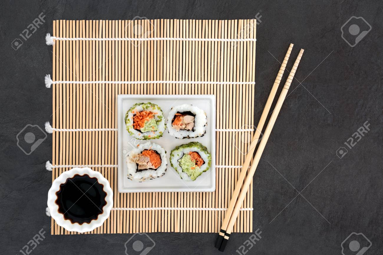 Japanese Sushi And Soy Sauce With Chopsticks On A Bamboo Mat