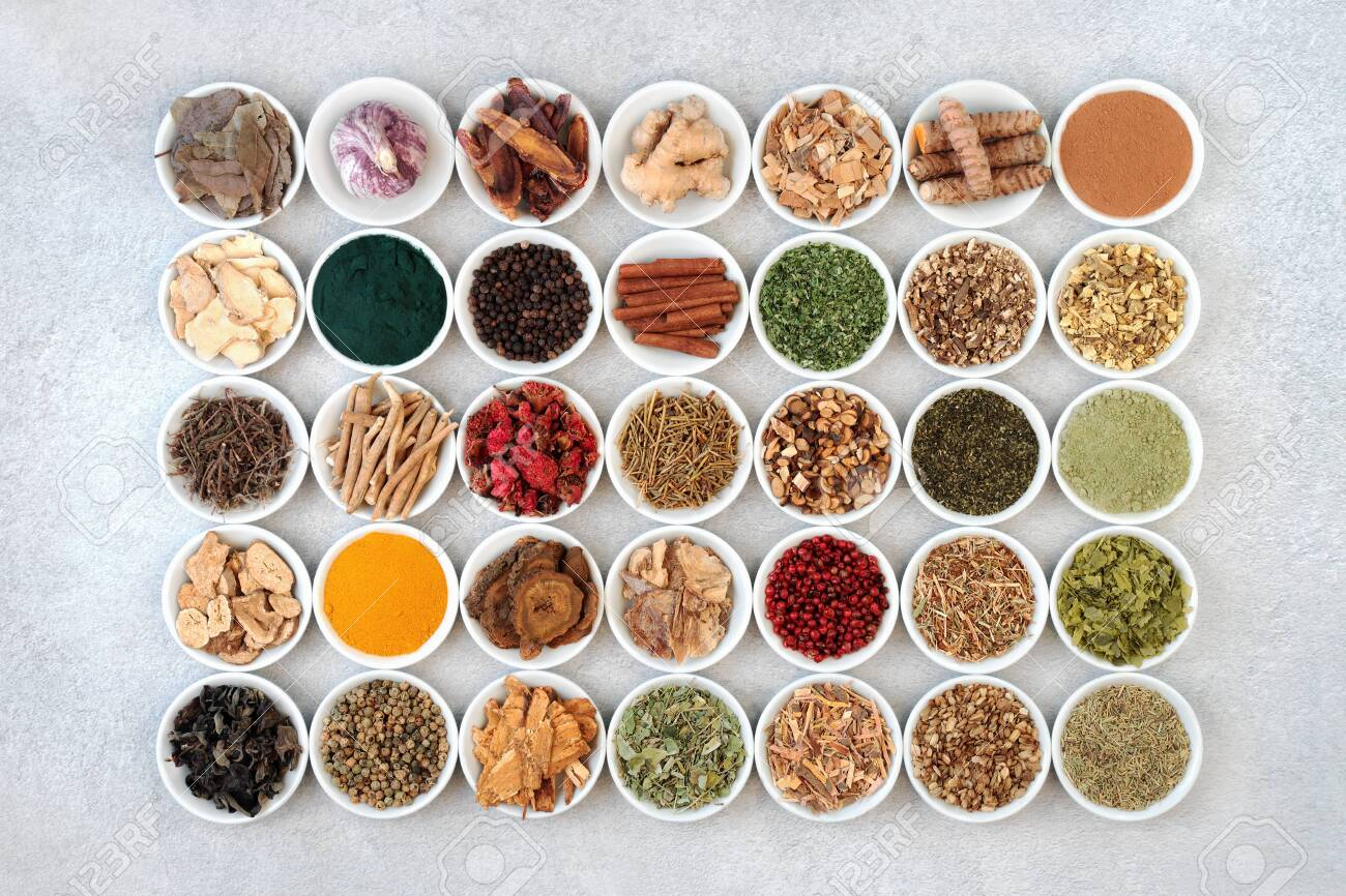 Super food collection for health, fitness and vitality in porcelain bowls including dietary supplement powders and herbs and spice used in natural and chinese herbal medicine. Flat lay. - 142046297