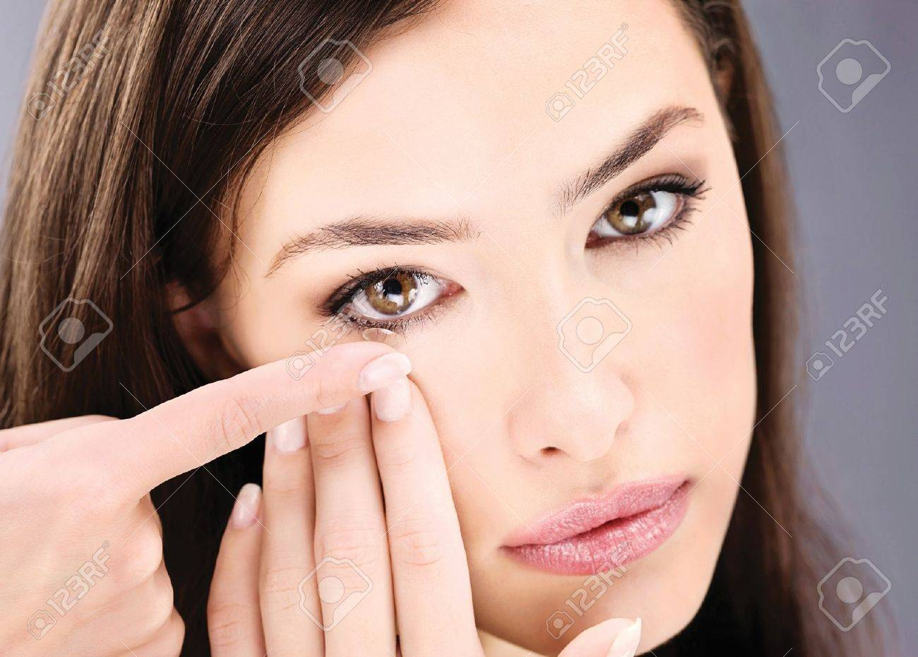 Close up of a woman putting contact lens in her eye Stock Photo - 12105928