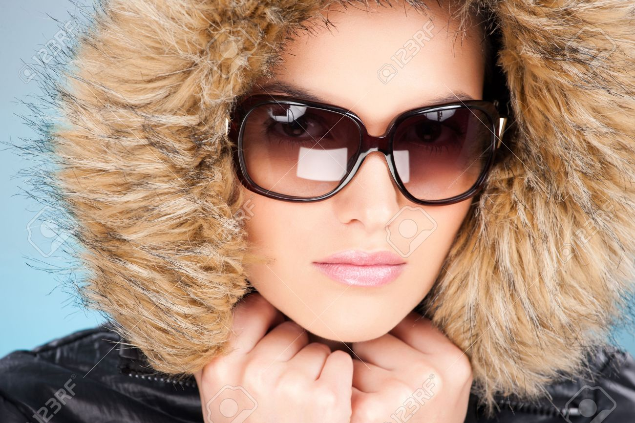 pretty woman wearing winter outfit with fur and glasses Stock Photo - 12369970