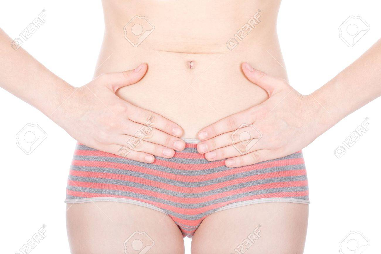Girl in uderwear having a menstrual pain, isolated on white background Stock Photo - 12369903