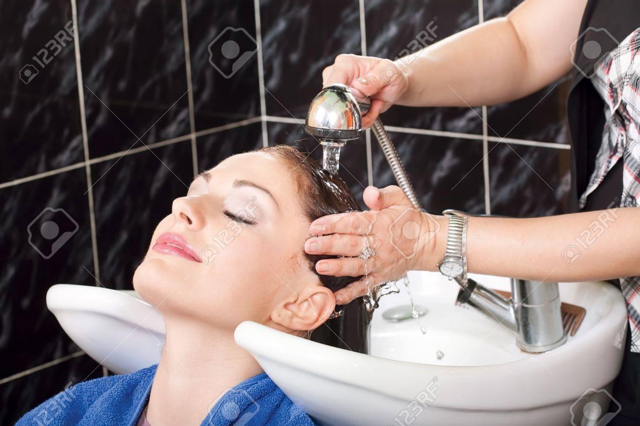 Hairdresser washing hair of customer Stock Photo - 12369989