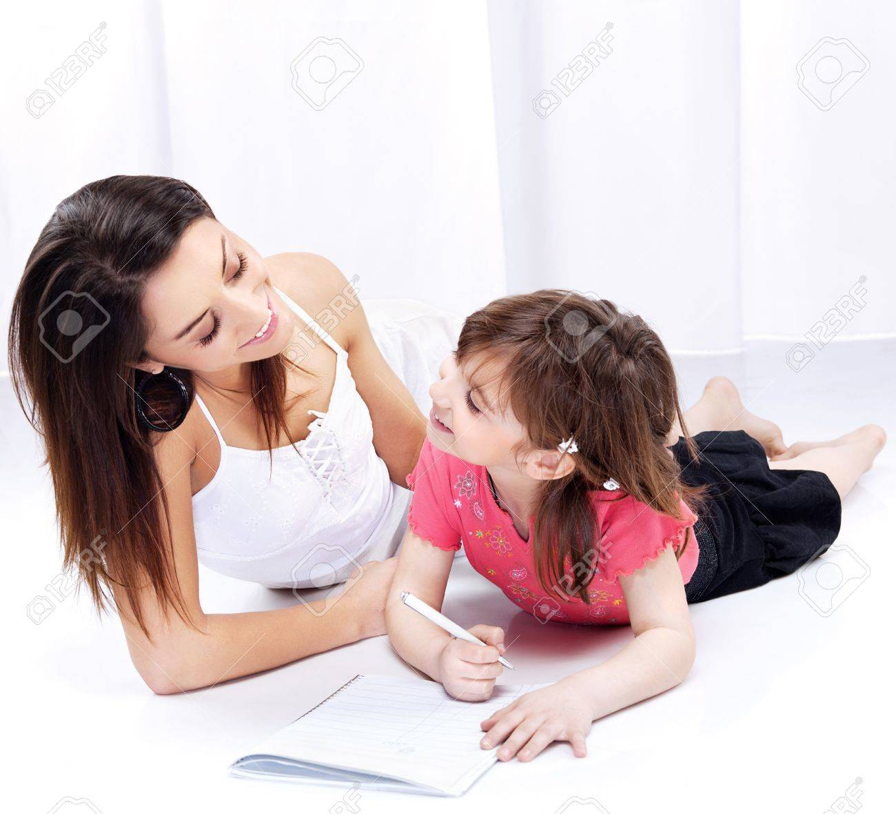 Woman and child drawing on notepad and laughing Stock Photo - 12789148