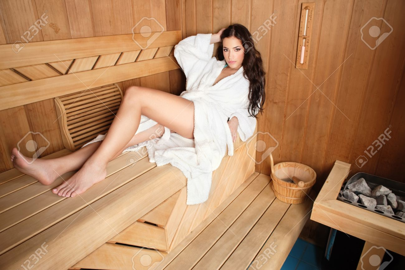 young woman relaxing in finnish type wooden sauna Stock Photo - 12789116