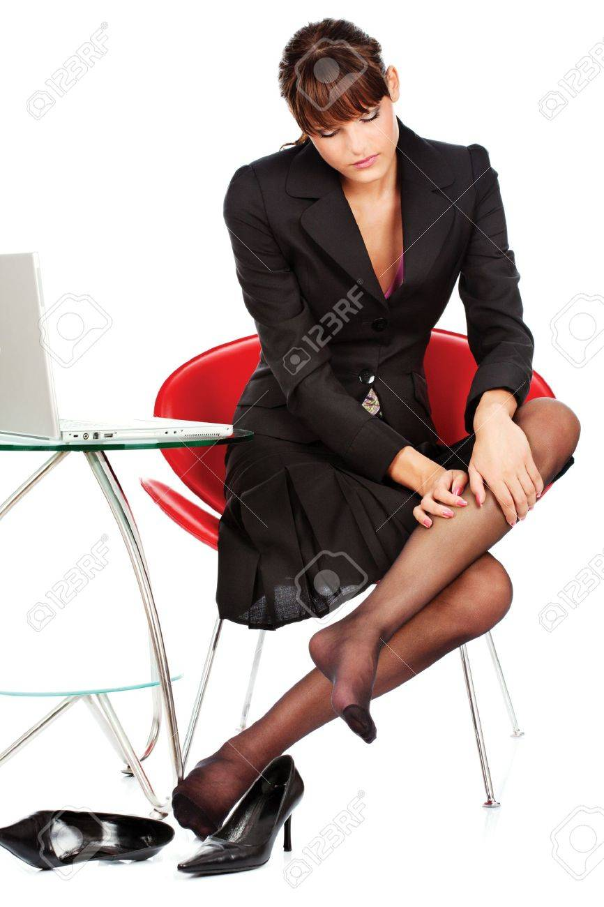 pretty business woman relaxing her leg with massage, isolated on white Stock Photo - 12788961