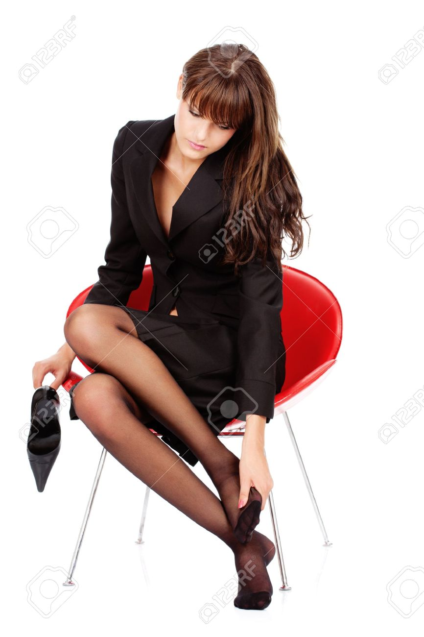 pretty business woman relaxing her feet with massage, isolated on white Stock Photo - 12788936