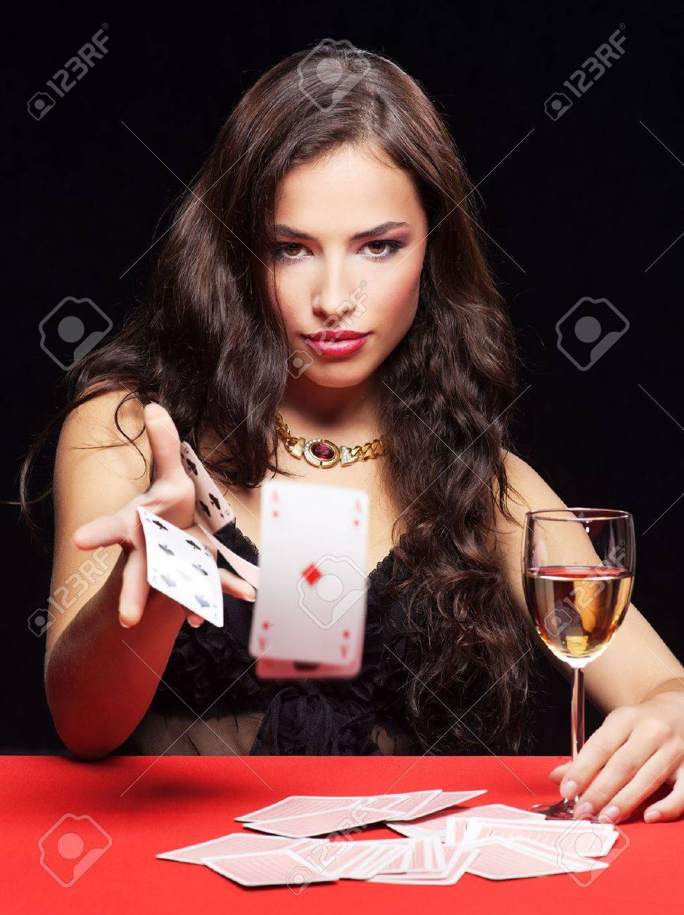 pretty young woman gambling on red table Stock Photo - 14100002