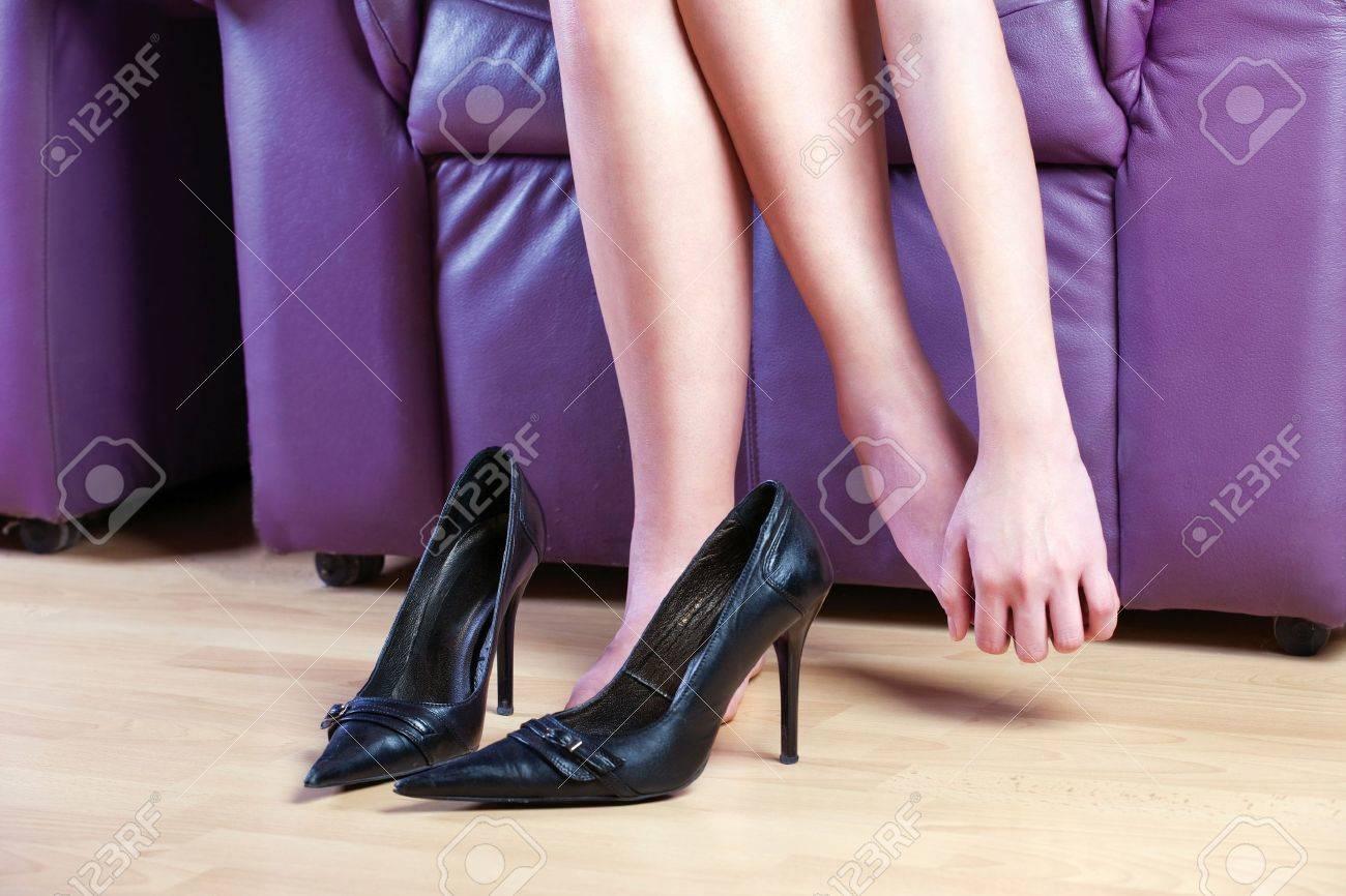 woman give herself foot massage Stock Photo - 14529786
