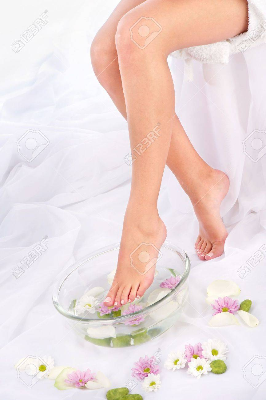 Slim legs in aromatherapy bowl, composition sided Stock Photo - 14770624