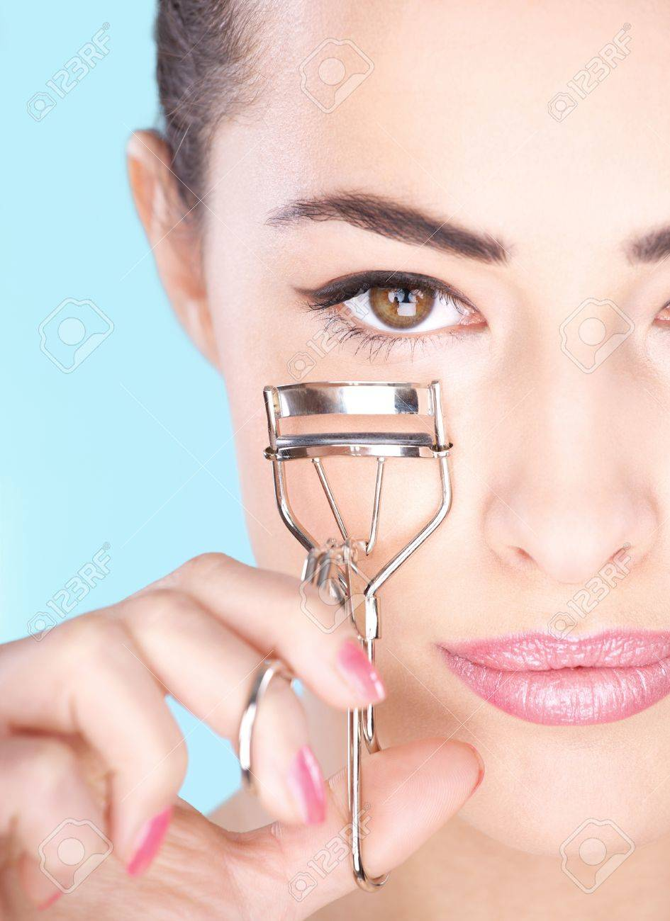 Pretty woman holding tool for eyelash Stock Photo - 14743202
