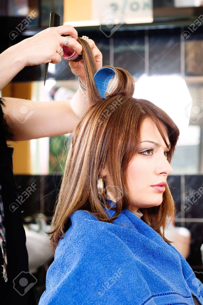 hairdresser putting rollers on customer's hair Stock Photo - 14881107