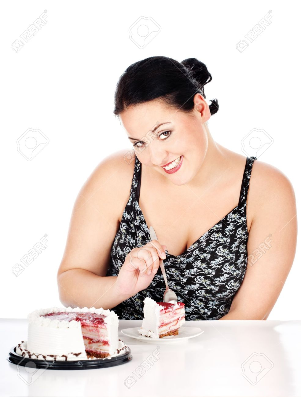 chubby woman eating slice of cake, isolated on white Stock Photo - 14880692