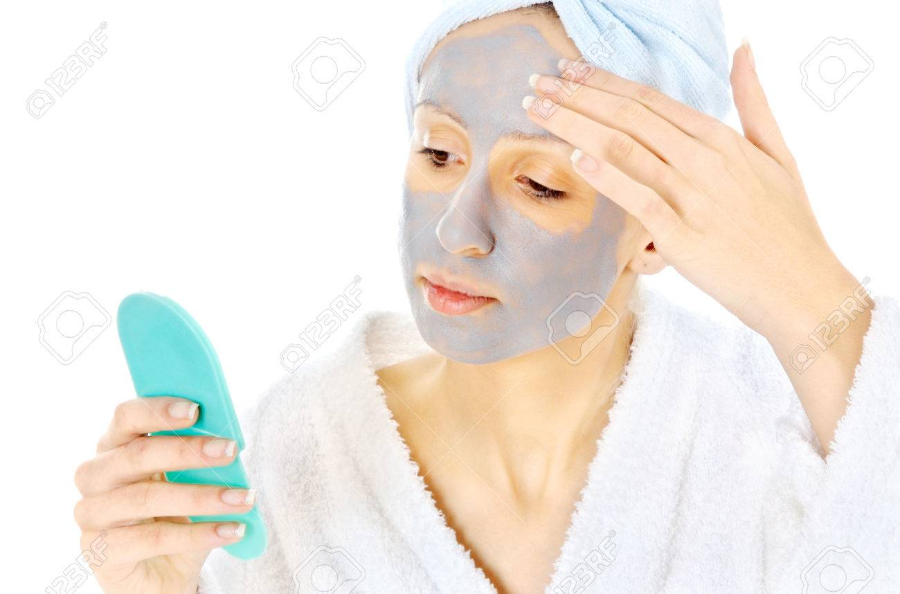 Young woman taking care of her skin Stock Photo - 23727471