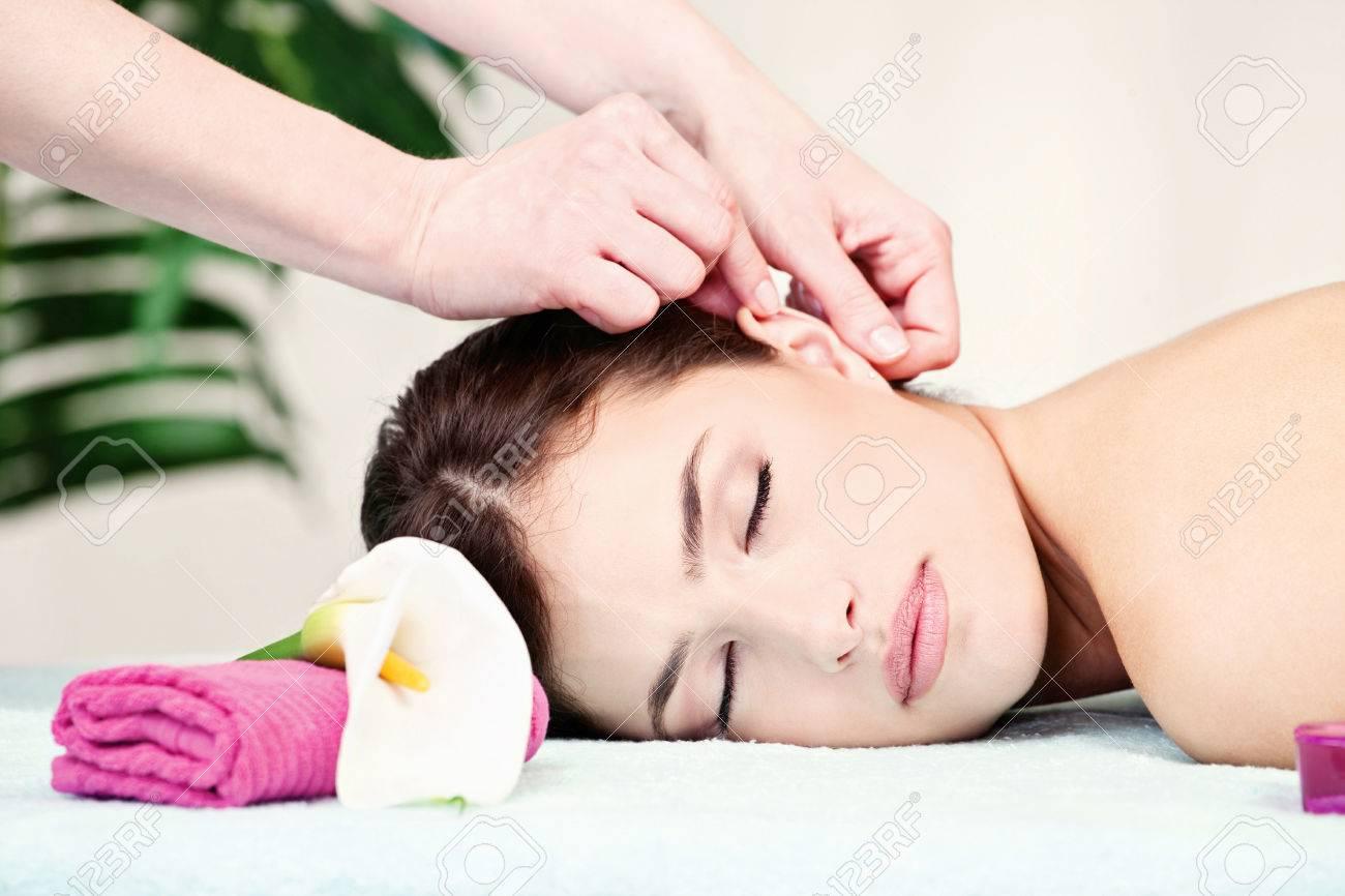 Pretty woman on ear massage in salon Stock Photo - 24198896