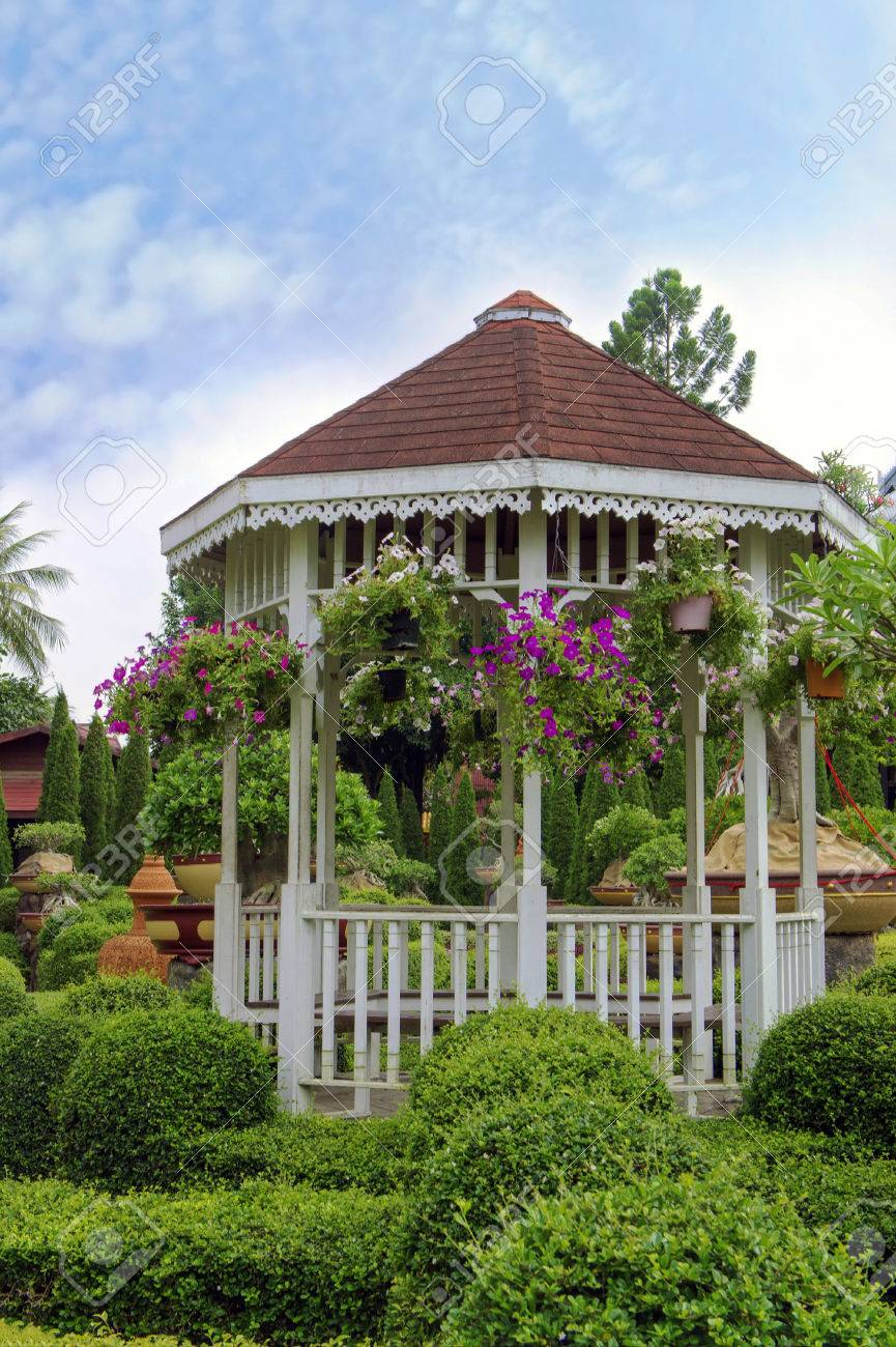 Outdoor Wooden Gazebo With Flowers In A Beautiful Garden Stock Photo 28331745