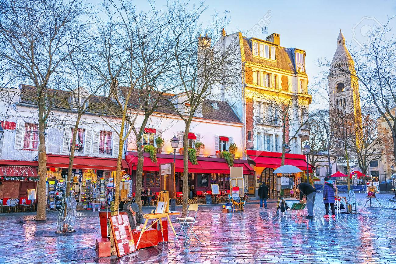 Place du Tertre in Montmartre in Paris. In area lot of souvenirs and handicrafts. In small houses are located cafes, restaurants and art galleries. - 86436442