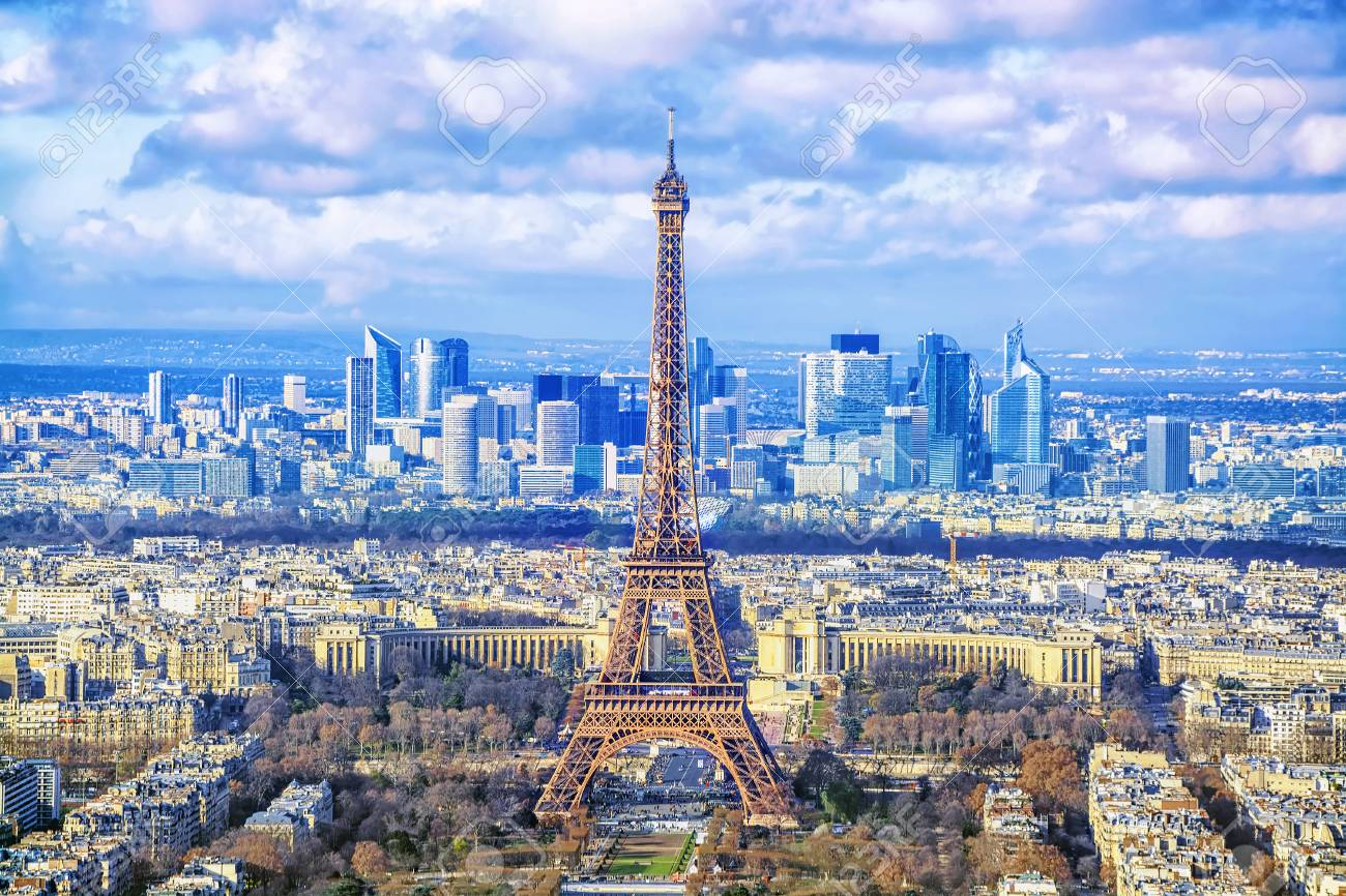 Paris cityscape. Aerial view of the main attractions of Paris Eiffel Tower on background of business district of La Defense, seen from Montparnasse skyscraper, France. - 87149419