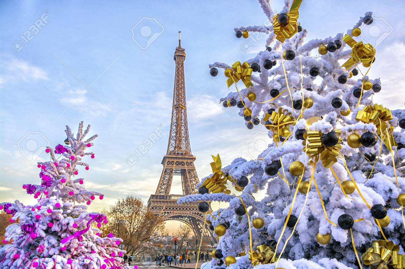 Eiffel Tower is the main attraction of Paris on the background of decorated Christmas trees in December. Travel Greeting Card with Christmas in Paris, France - 87173313