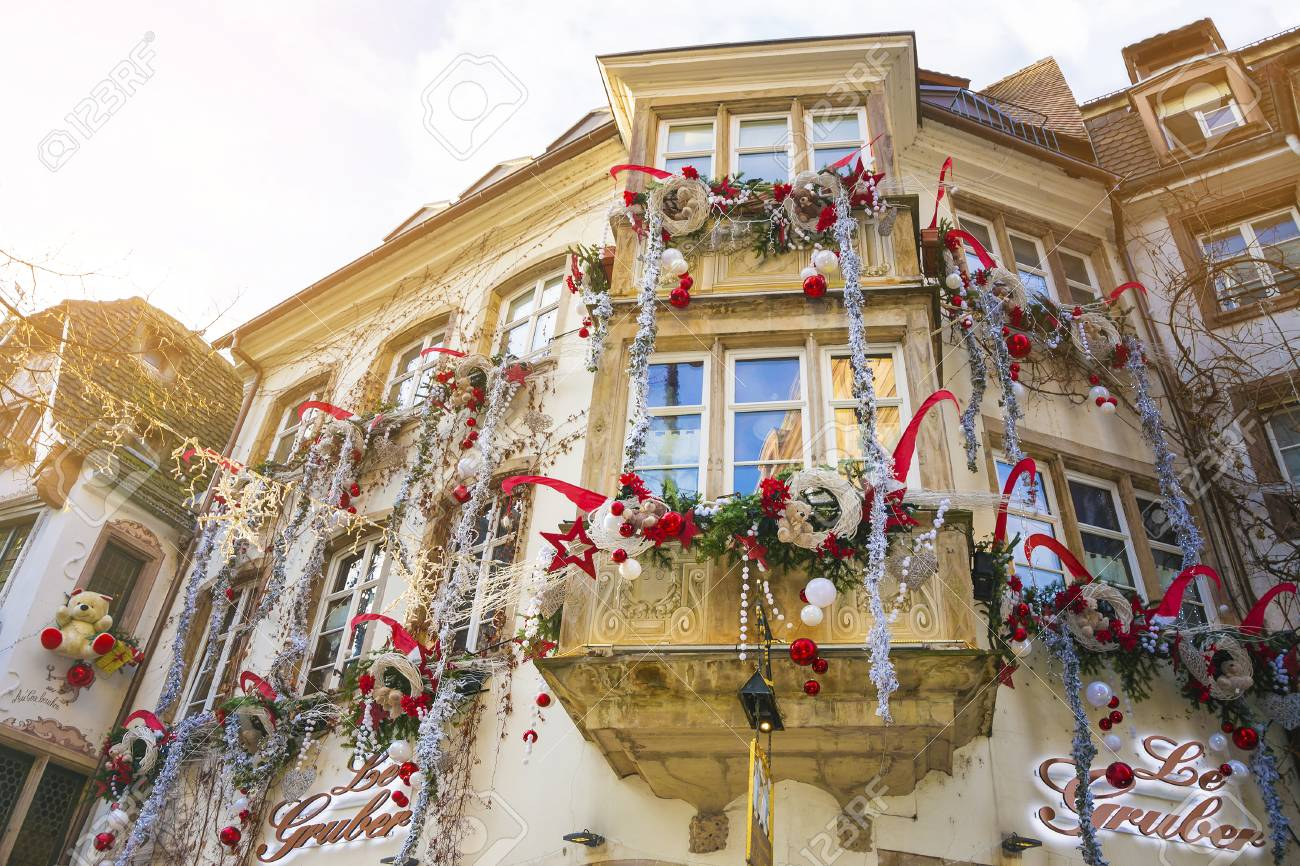 Strasbourg, Alsace, France - December 12, 2016: Facades and windows of houses decorated for Christmas in the medieval city of Strasbourg - the capital of Christmas - 87636163