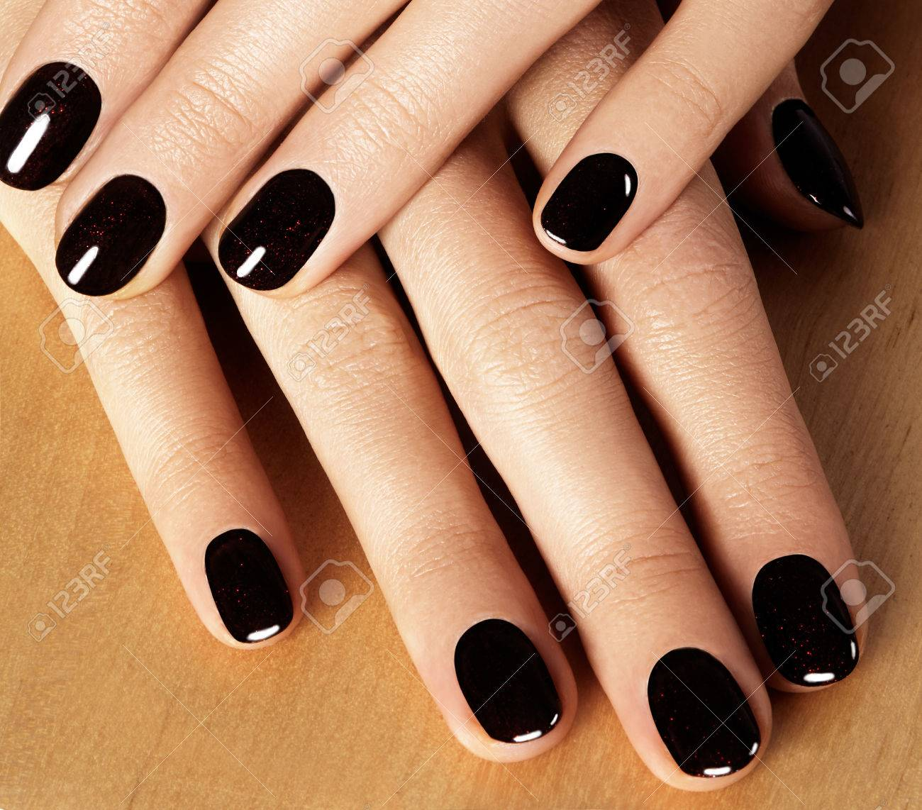 Black Nail Polish. Manicured Nails With Black Nail Polish. Manicure ...