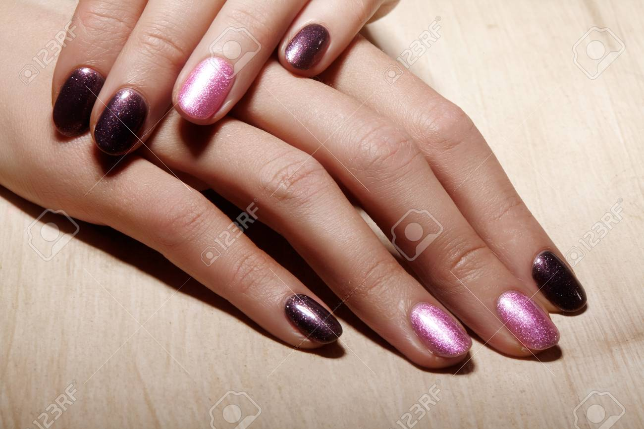 Bright Pink And Black Nail Polish Wit Sparkles. Manicured Nails ...