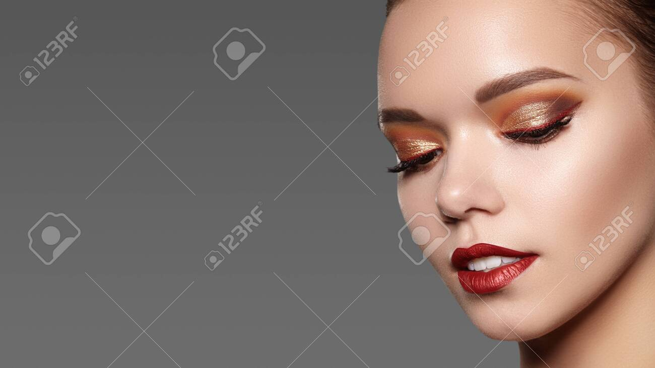 Beautiful Woman with Professional Makeup. Celebrate Style Eye Make-up, Perfect Eyebrows, Shine Skin. Bright Fashion Look. - 121699496