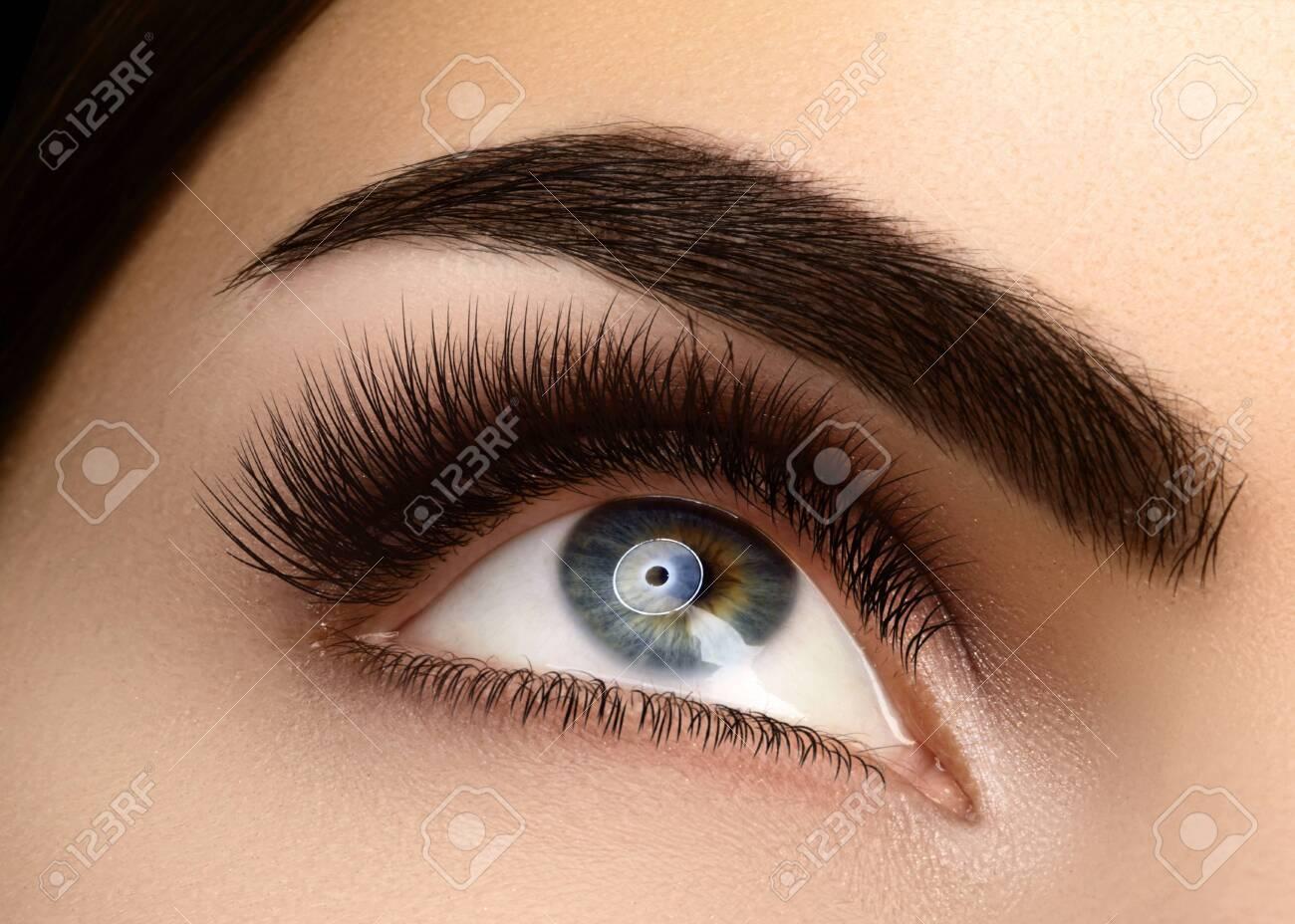 Beautiful Macro Female Eye with Extreme Long Eyelashes and Celebrate Makeup. Perfect Shape Make-up, Fashion Long Lashes. Cosmetics and make-up. Closeup macro shot of fashion eyes visage - 131922003