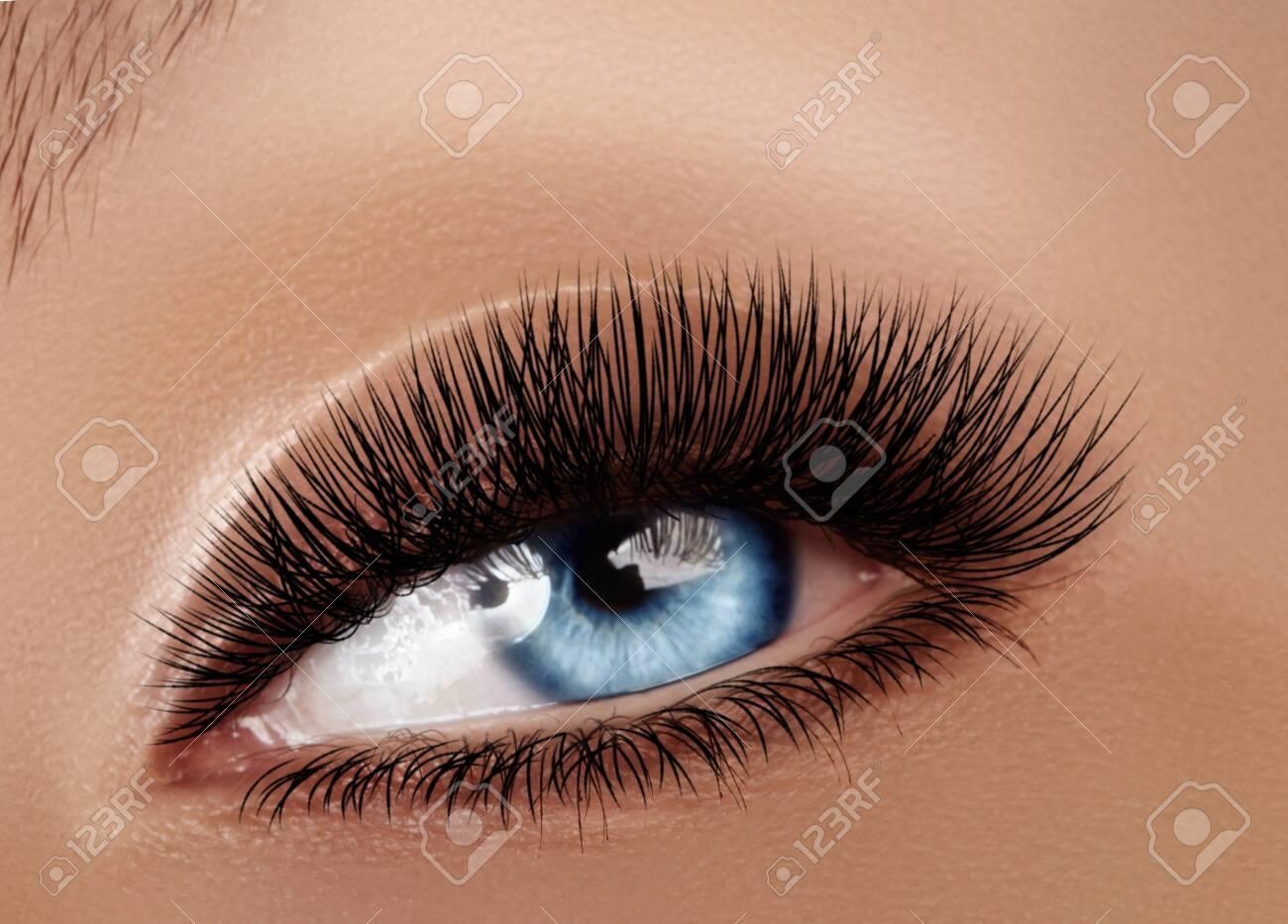 Beautiful Macro Female Eye with Extreme Long Eyelashes and Celebrate Makeup. Perfect Shape Make-up, Fashion Long Lashes. Cosmetics and make-up. Closeup macro shot of fashion eyes visage - 131921823