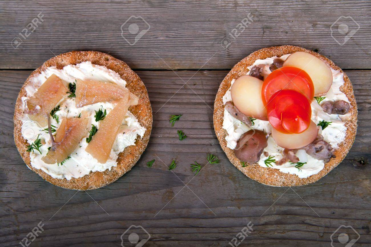 Two sandwiches with Swedish herring on the wooden table Stock Photo - 16058968